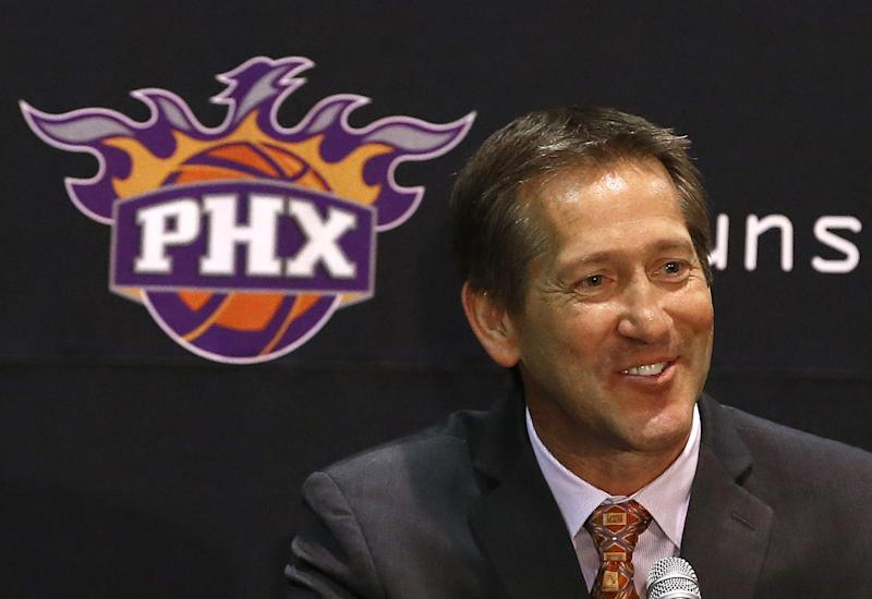 Jeff Hornacek smiles as he is introduced as the Phoenix Suns new head basketball coach during a news conference, Tuesday, May 28, 2013, in Phoenix. (AP Photo/Ross D. Franklin)