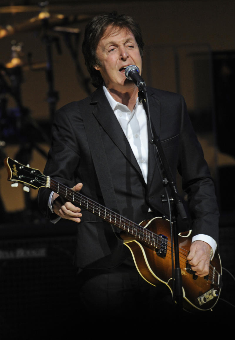 Paul McCartney performs in concert for the first time at Harlem's famed Apollo Theater, Monday, Dec. 13, 2010 in New York. (AP Photo/Henny Ray Abrams)