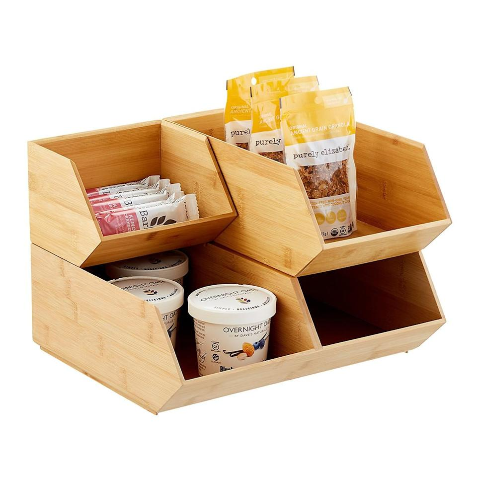 "<p>These <a href=""https://www.popsugar.com/buy/Stackable-Bamboo-Storage-Bins-498154?p_name=Stackable%20Bamboo%20Storage%20Bins&retailer=containerstore.com&pid=498154&price=10&evar1=moms%3Aus&evar9=45714253&evar98=https%3A%2F%2Fwww.popsugar.com%2Ffamily%2Fphoto-gallery%2F45714253%2Fimage%2F46718618%2FStackable-Bamboo-Storage-Bins&list1=shopping%2Corganization%2Ckitchen%20organization%2Chome%20organization&prop13=mobile&pdata=1"" rel=""nofollow"" data-shoppable-link=""1"" target=""_blank"" class=""ga-track"" data-ga-category=""Related"" data-ga-label=""https://www.containerstore.com/s/kitchen/pantry-organizers/stackable-bamboo-storage-bins/12d?productId=11005650"" data-ga-action=""In-Line Links"">Stackable Bamboo Storage Bins</a> ($10-$25) are so versatile and look stylish.</p>"