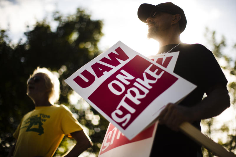 FILE - In this Sept. 16, 2019 file photo, union members picket outside a General Motors facility in Langhorne, Pa. The strike against GM by United Auto Workers entered its second week Monday, Sept. 23 with progress reported in negotiations but no clear end in sight. Bargainers met all weekend and returned to talks Monday morning as the strike entered its eighth day.  (AP Photo/Matt Rourke, File)