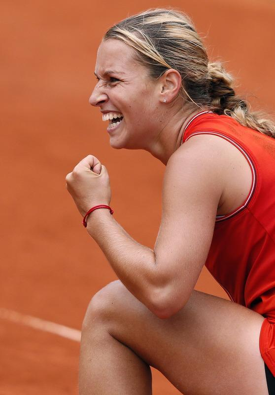 Slovakia's Dominika Cibulkova celebrates after winning against Belarus Victoria Azarenka during their Women's Singles 4th Round tennis match of the French Open tennis tournament at the Roland Garros stadium, on June 3, 2012 in Paris. AFP PHOTO / KENZO TRIBOUILLARDKENZO TRIBOUILLARD/AFP/GettyImages