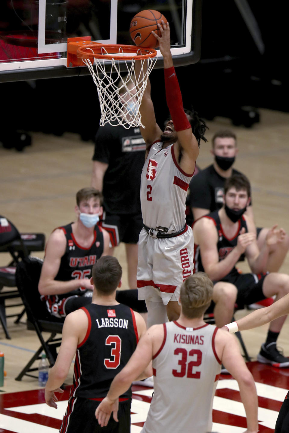 Stanford guard Bryce Wills (2) dunks in front of Utah guard Pelle Larsson (3) during the first half of an NCAA college basketball game Saturday, Feb. 13, 2021, in Stanford, Calif. (AP Photo/Scot Tucker)