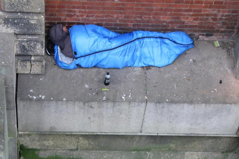 Homeless people have defended a man's decision to sleep dangerously close to the edge of Charing Cross Bridge: Rex Features