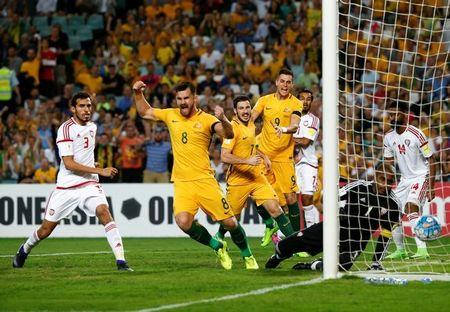 Football Soccer - Australia vs United Arab Emirates - 2018 World Cup Qualifying Asian Zone - Group B - Sydney Football Stadium, Sydney, Australia - 28/3/17 - Australia's Bailey Wright, Mathew Leckie and Tomi Juric celebrate after teammate Jackson Irvine (unseen) scored a goal against the UAE. REUTERS/David Gray