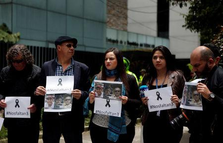 FILE PHOTO: Colombian journalists gather in front of the Ecuadorean embassy to protest against the murder of journalist Javier Ortega, photographer Paul Rivas and their driver Efrain Segarra in Bogota, Colombia April 16, 2018. Picture taken April 16, 2018. REUTERS/Jaime Saldarriaga