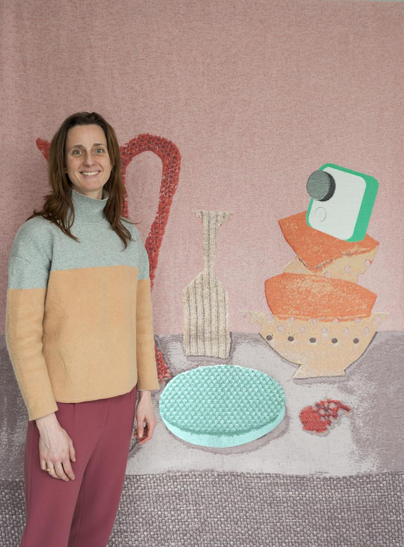 Artist Kiki van Eijk with a rendering of a wall hanging she'll create for the installation.