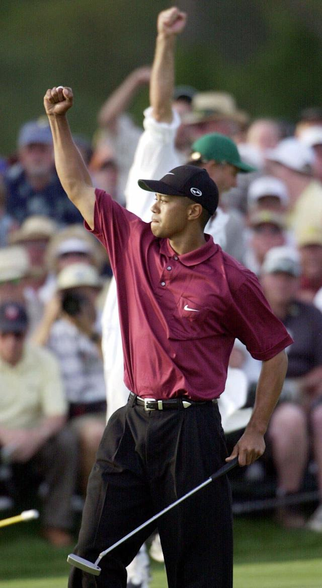 <p>Tiger Woods reacts on the 18th hole after winning the 2001 Masters at the Augusta National Golf Club in Augusta, Ga., Sunday, April 8, 2001. Woods captured this second Masters title, defeating David Duval by two strokes. (AP Photo/Dave Martin) </p>