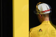 Slovenia's Tadej Pogacar, wearing the overall leader's yellow jersey, leaves the podium after the twentieth stage of the Tour de France cycling race, an individual time-trial over 30.8 kilometers (19.1 miles) with start in Libourne and finish in Saint-Emilion, France, Saturday, July 17, 2021. (AP Photo/Daniel Cole)