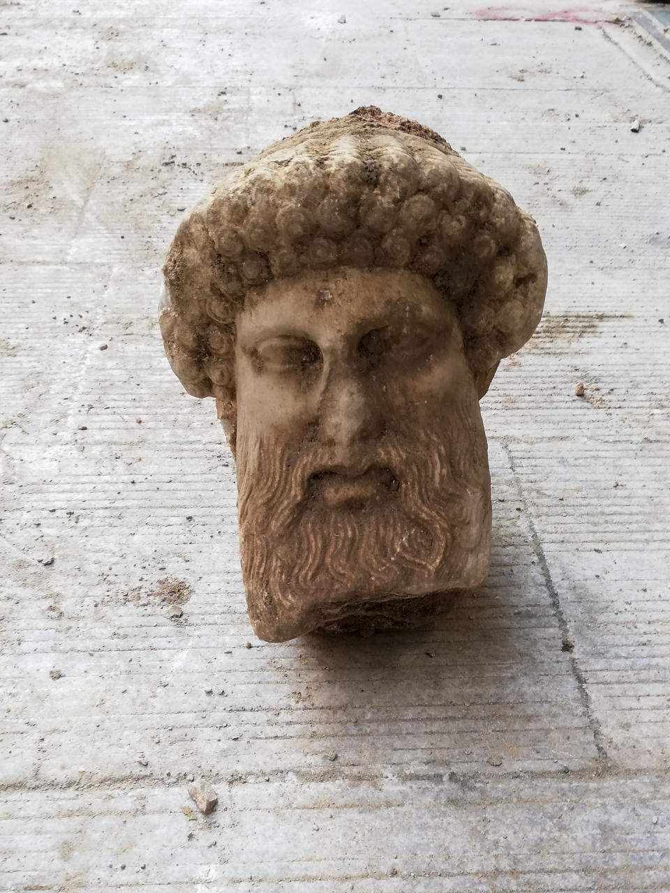 "In this undated photo, provided by the Greek Culture Ministry on Sunday, Nov. 15, 2020, a head of the ancient god Hermes is pictured after being found during sewage works in central Athens. The ministry said Sunday that the head, depicting Hermes at a ""mature age"", one of many that served as street markers in ancient Athens, appears to be from around 300 BC, that is, either from the late 4th century BC, or the early 3rd century. (Greek Culture Ministry via AP)"
