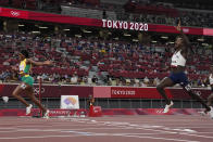 Elaine Thompson-Herah, left, of Jamaica, wins the final of the women's 200-meters from Christine Mboma, of Namibia, at the 2020 Summer Olympics, Tuesday, Aug. 3, 2021, in Tokyo. (AP Photo/David J. Phillip)
