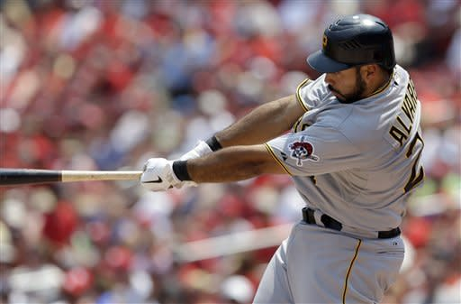 Pittsburgh Pirates' Pedro Alvarez hits a grand slam during the first inning of a baseball game against the St. Louis Cardinals Saturday, June 30, 2012, in St. Louis. (AP Photo/Jeff Roberson)