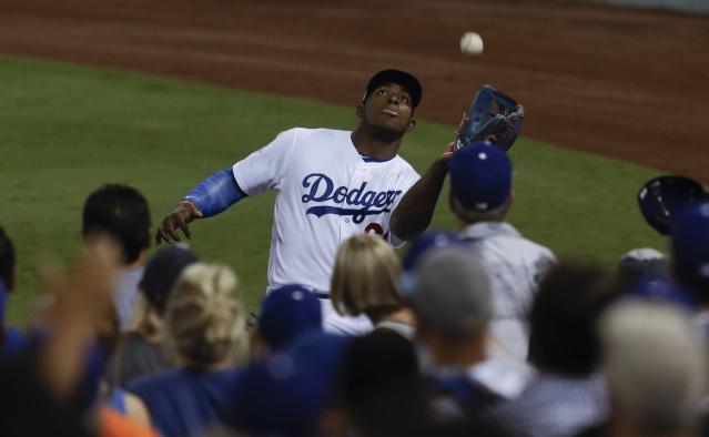 <p>Los Angeles Dodgers right fielder Yasiel Puig catches a fly ball hit by Houston Astros' Jose Altuve during the fifth inning of Game 2 of baseball's World Series Wednesday, Oct. 25, 2017, in Los Angeles. (AP Photo/Alex Gallardo) </p>