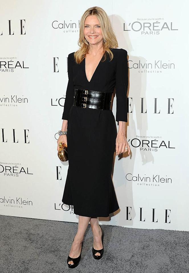 "Michelle Pfeiffer has been MIA for the majority of the year, but she made a triumphant return at Monday evening's 18th Annual <i>ELLE</i> Women In Hollywood Tribute. The 53-year-old actress -- who'll next be seen in Garry Marshall's ""New Year's Eve -- turned heads in a chic Alexander McQueen frock and massive McQueen belt. A diamond-encrusted cuff, gold clutch, and black platform peep-toes completed her flawless look. (10/17/11)"
