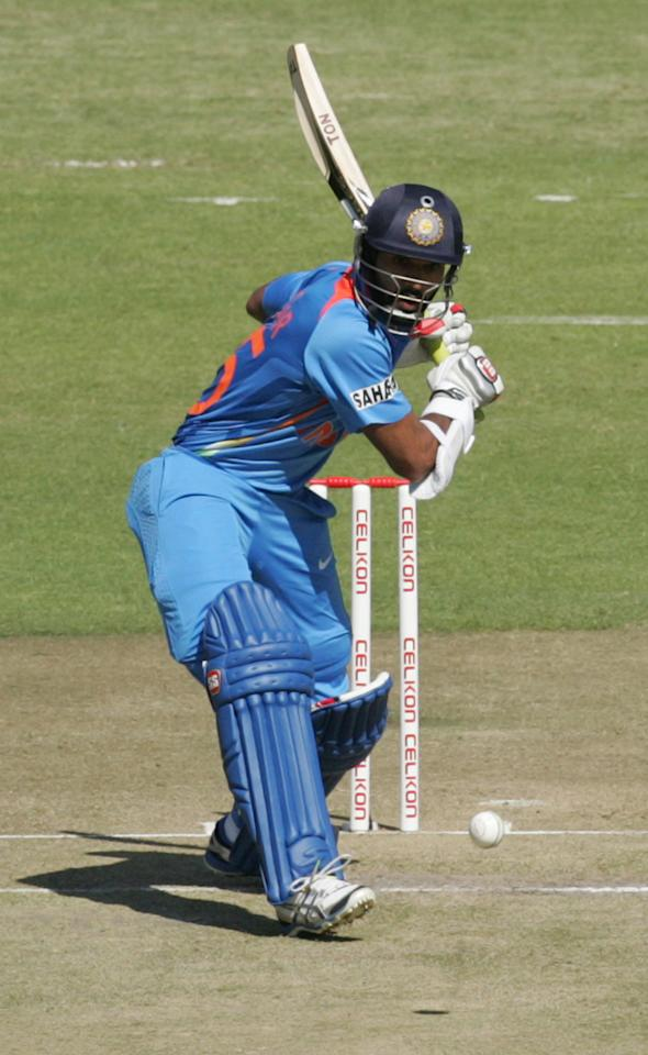 India's Shikar Dhawan bats during the first match of the five match ODI cricket series between India and hosts Zimbabwe at the Harare Sports Club on July 24, 2013. AFP/PHOTO Jekesai Njikizana.        (Photo credit should read JEKESAI NJIKIZANA/AFP/Getty Images)