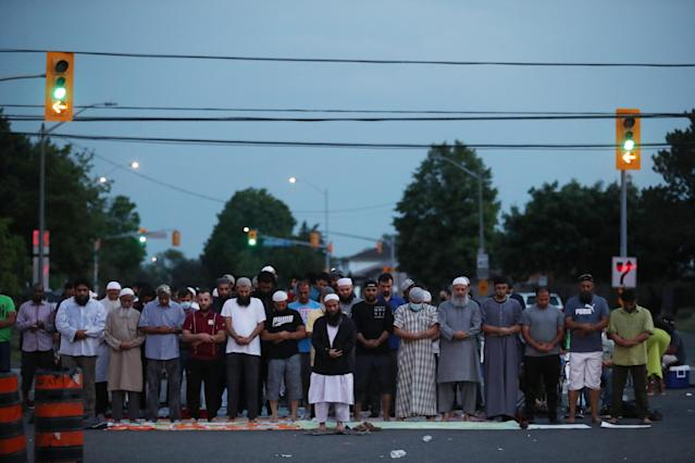 Prayers are held in the intersection. After a rally and a march, protesters continue to occupy the intersection of Goreway and Morning Star, as they hold vigil outside the Malton apartment building where 62-year-old Ejaz Choudry was fatally shot by Peel police officers Saturday after police responded to a call for a mental-health crisis. June 22, 2020. (Steve Russell/Toronto Star via Getty Images)