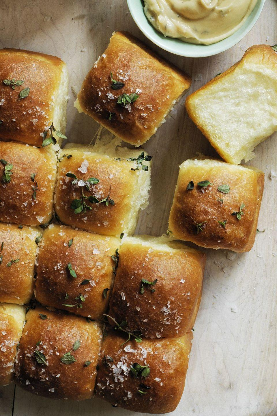 """<p>Because no meal is complete without rolls (and lots of butter).</p><p><em><strong><a href=""""https://www.womansday.com/food-recipes/food-drinks/recipes/a60501/sweet-parker-house-rolls-recipe/"""" rel=""""nofollow noopener"""" target=""""_blank"""" data-ylk=""""slk:Get the Sweet Parker House Rolls recipe."""" class=""""link rapid-noclick-resp"""">Get the Sweet Parker House Rolls recipe.</a></strong></em></p>"""