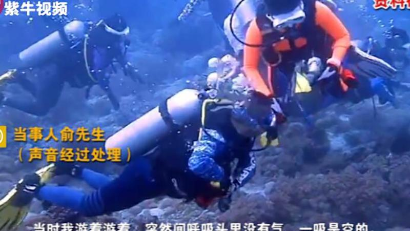 Chinese tourist sorry for scuba tank 'pranks' on diving trip in Philippines