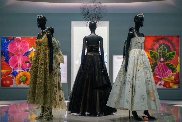 """Dresses by French fashion designer Christian Dior on display at the """"Designer of Dreams"""" exhibition at the Brooklyn Museum in New York, on September 7, 2021 (AFP/Angela Weiss)"""