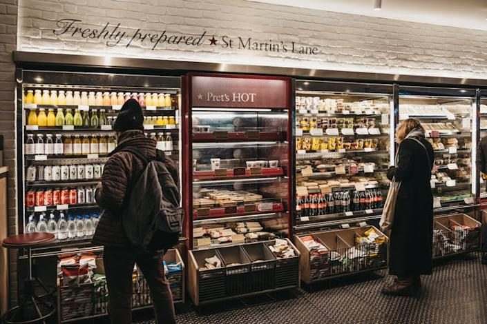 """<span class=""""caption"""">The food industry encourages eating on the go.</span> <span class=""""attribution""""><a class=""""link rapid-noclick-resp"""" href=""""https://www.shutterstock.com/image-photo/london-uk-january-5-2019-people-1279348291?src=enpf8mZBbl7i6JFzaPjD6A-1-94"""" rel=""""nofollow noopener"""" target=""""_blank"""" data-ylk=""""slk:Alena Veasey/Shutterstock"""">Alena Veasey/Shutterstock</a></span>"""