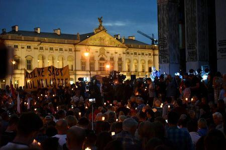 Protesters gather during candlelight rally to protest against judicial reforms in front of the Supreme Court in Warsaw