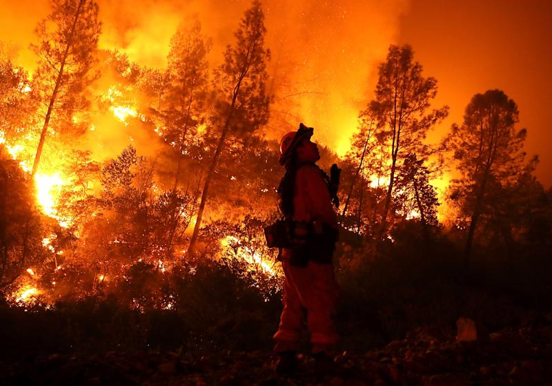 A firefighter monitors a backfire while battling the Mendocino Complex blaze on Aug. 7 near Lodoga, California. So far this year, six people have died fighting wildfires in the state. (Justin Sullivan / Getty Images)