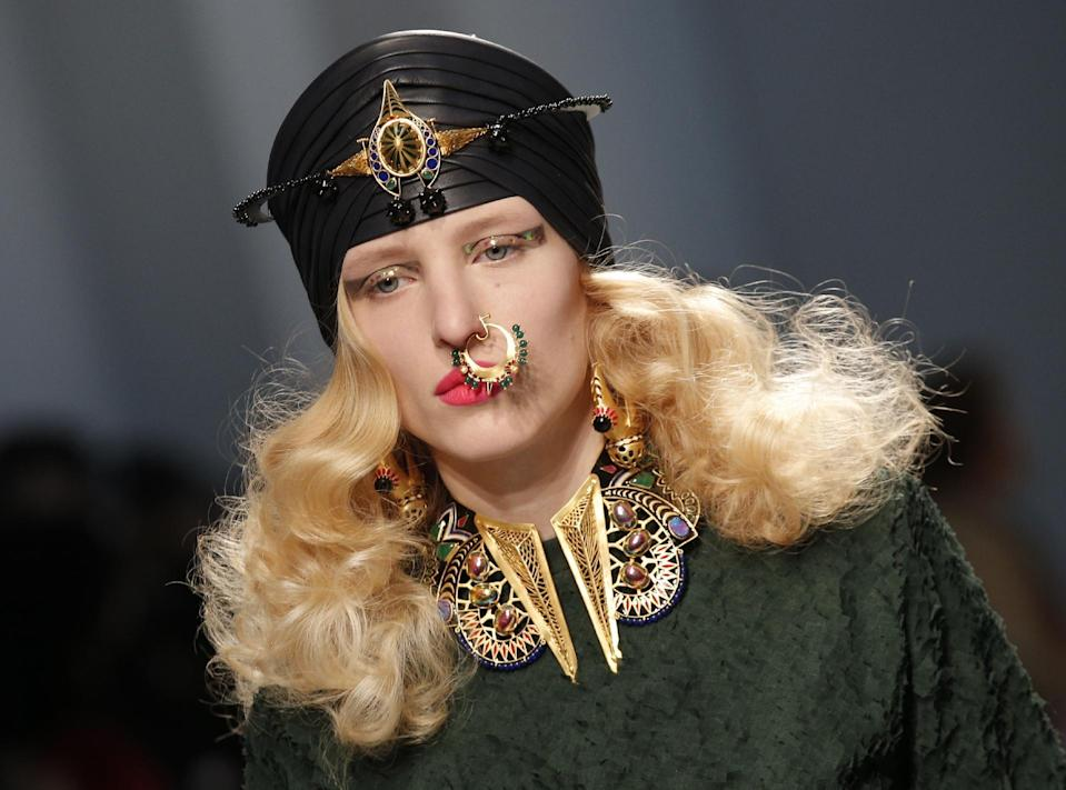 A model presents a creation by Indian fashion designer Manish Arora Ready to Wear's Fall-Winter 2013-2014 fashion collection, presented, Thursday, Feb.28, 2013 in Paris. (AP Photo/Christophe Ena)