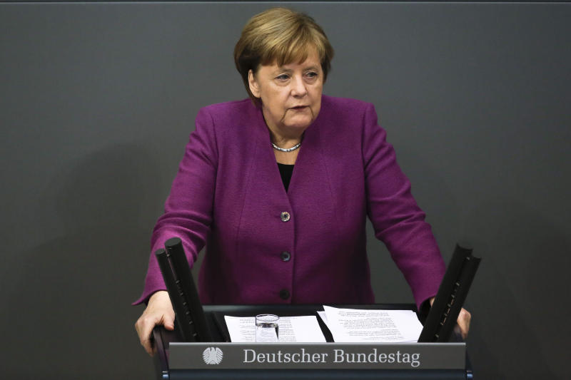 German Chancellor Angela Merkel delivers her speech about the European policy ahead of a EU summit at the parliament Bundestag in Berlin, Thursday, Feb. 22, 2018. (AP Photo/Markus Schreiber)