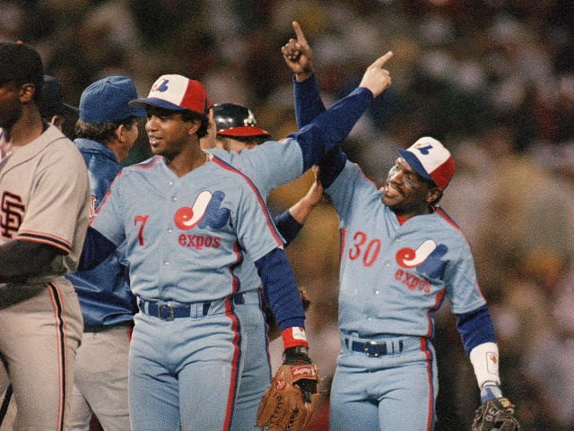 FILE - In this Tuesday, July 15, 1987, file photo, All-Star baseball game Most Valuable Player Tim Raines (30) of the Montreal Expos celebrates the National League's 2-0 victory over the American League with his teammates at Oakland Coliseum, in Oakland, Calif. Raines started wearing the tricolor cap as a teen and proudly sported the Montreal Expos logo for years, all the way onto his Hall of Fame plaque. Now known as the Washington Nationals, the team is set to play in the franchise's first World Series. (AP Photo/Lenny Ignelzi, File)