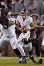 Texas A&M defensive lineman Tyree Johnson, rear, sacks Alabama quarterback Bryce Young during the first half of an NCAA college football game on Saturday, Oct. 9, 2021, in College Station, Texas. (AP Photo/Sam Craft)