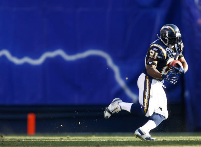 This picture of LaDainian Tomlinson seemingly leaving a bolt of lightning in his wake is an apt comparison to his 2006 season. (Photo by Rob Tringali/Sportschrome/Getty Images)