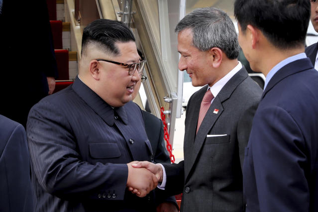 <p>North Korean leader Kim Jong Un, left, is greeted by Singapore Minister for Foreign Affairs Dr. Vivian Balakrishnan at the Changi International Airport, Sunday, June 10, 2018, in Singapore, ahead of a summit with President Donald Trump. (Photo: Ministry of Communications and Information Singapore via AP) </p>