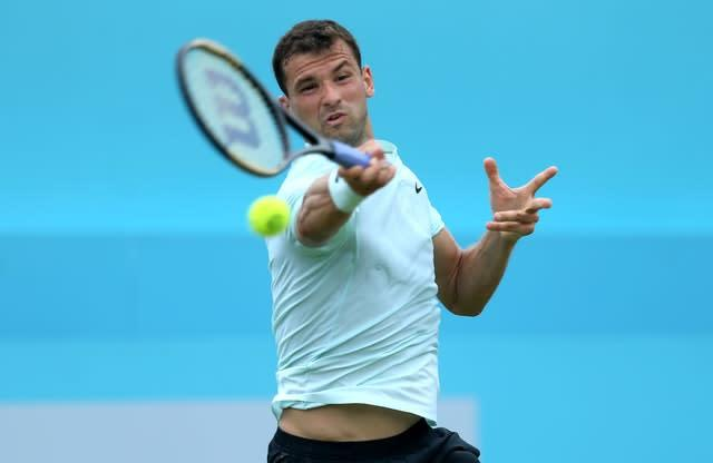 Grigor Dimitrov announced he had tested positive for COVID-19 after his match against Coric. (Steven Paston/PA)