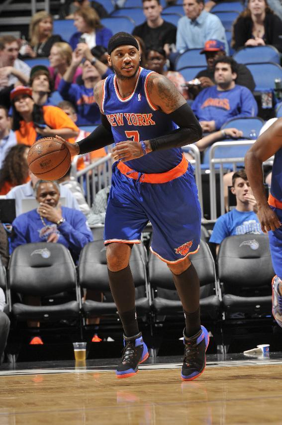 ORLANDO, FL - DECEMBER 23: Carmelo Anthony #7 of the New York Knicks dribbles up the court against the Orlando Magic during the game on December 23, 2013 at Amway Center in Orlando, Florida. (Photo by Fernando Medina/NBAE via Getty Images)