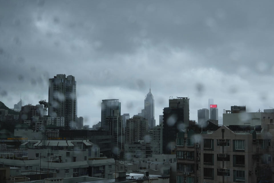 A Hong Kong general view is seen as Typhoon Kompasu passes in Hong Kong Wednesday, Oct. 13, 2021. Hong Kong suspended classes, stock market trading and government services as the typhoon passed south of the city Wednesday. (AP Photo/Vincent Yu)