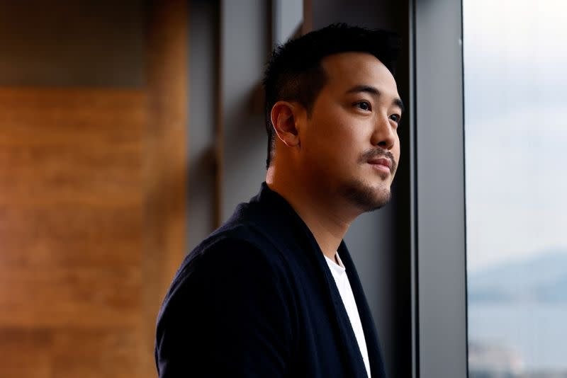 """FILE PHOTO: Derek Tsang, director of """"Better Days"""", poses after interview with Reuters, in Hong Kong"""