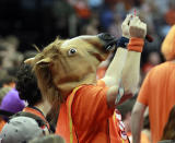 A Virginia fan wears a horse head during an NCAA college basketball game against Norfolk State Sunday Nov. 16, 2014 in Charlottesville, Va. (AP Photo/Andrew Shurtleff)
