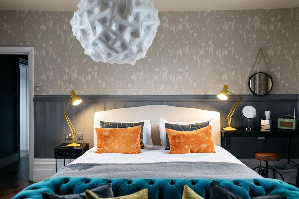 """<p>Head off to the arty town of Ditchling for a super-stylish country break with beach in reach. This charming boutique country bolthole was build in 1560 and is bursting with character (blackened beams, wonky ceilings, cosy fireplaces), yet boats a design-led interior. </p><p>Nestled in the South Downs National Park, you're spoilt for choice in the country walks department, while bustling Brighton is just 20 minutes away. But we doubt you'll even want to leave your room...</p><p><strong>Distance from London by train:</strong> The closest train station is Hassocks, a 5-minute taxi ride away, and direct trains from London take just under an hour.</p><p><a href=""""https://www.redescapes.com/offers/east-sussex-ditchling-bull-hotel"""" rel=""""nofollow noopener"""" target=""""_blank"""" data-ylk=""""slk:Read our review of The Bull"""" class=""""link rapid-noclick-resp"""">Read our review of The Bull</a></p><p><a class=""""link rapid-noclick-resp"""" href=""""https://go.redirectingat.com?id=127X1599956&url=https%3A%2F%2Fwww.booking.com%2Fhotel%2Fgb%2Fthe-bull-ditchling.en-gb.html%3Faid%3D2070929%26label%3Dhotels-outside-london&sref=https%3A%2F%2Fwww.redonline.co.uk%2Ftravel%2Finspiration%2Fg34469437%2Fhotels-outside-london%2F"""" rel=""""nofollow noopener"""" target=""""_blank"""" data-ylk=""""slk:CHECK AVAILABILITY"""">CHECK AVAILABILITY</a></p>"""
