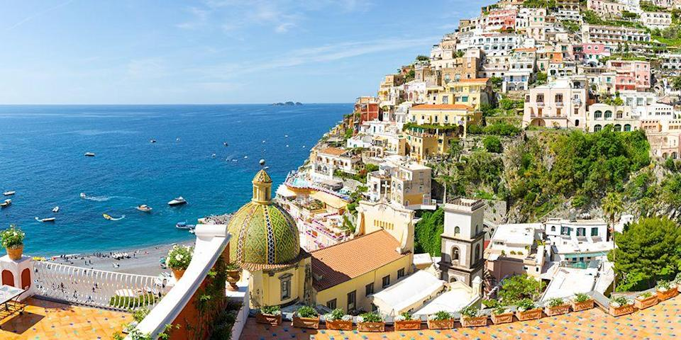 """<p>One can never run out of options when it comes to jaw-droppingly beautiful spots in Italy, but the <a href=""""https://www.tripadvisor.com/Tourism-g187779-Amalfi_Coast_Campania-Vacations.html"""" rel=""""nofollow noopener"""" target=""""_blank"""" data-ylk=""""slk:Amalfi Coast"""" class=""""link rapid-noclick-resp"""">Amalfi Coast</a> just might take the <em>torta</em>. Just south of Naples, this wildly scenic stretch, with towns like <span class=""""redactor-unlink"""">Ravello</span>, <span class=""""redactor-unlink"""">Amalfi</span>, and <span class=""""redactor-unlink"""">Positano</span>, is known for its colorful houses built into steep hills (and they're often right above <a href=""""https://www.bestproducts.com/fun-things-to-do/news/a1736/black-sand-beaches-in-the-world/"""" rel=""""nofollow noopener"""" target=""""_blank"""" data-ylk=""""slk:black-sand beaches"""" class=""""link rapid-noclick-resp"""">black-sand beaches</a>). <br></p>"""