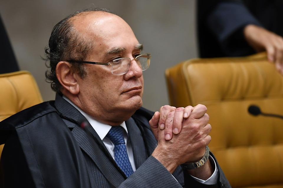 Brazilian Supreme Court judge Gilmar Mendes gestures at the start of Brazil's Supreme Court ruling on whether former president Luiz Inacio Lula da Silva should start a 12 year prison sentence for corruption in Brasilia on April 4, 2018 Tension soared in Latin America's largest country ahead of the court showdown, with both backers and opponents of Lula -currently the heavy favorite for the October polls- warning of a threat to democracy. / AFP PHOTO / EVARISTO SA        (Photo credit should read EVARISTO SA/AFP via Getty Images)