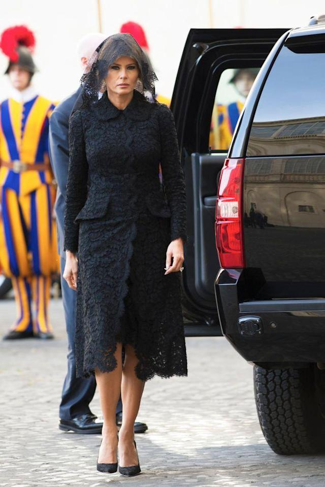 """<p>FLOTUS wore a <a href=""""http://www.townandcountrymag.com/style/fashion-trends/g9923727/pope-dress-code-presidents-royals/"""" rel=""""nofollow noopener"""" target=""""_blank"""" data-ylk=""""slk:very traditional Vatican ensemble"""" class=""""link rapid-noclick-resp"""">very traditional Vatican ensemble</a> to meet with the Pope: a modest black dress and a black lace veil by Italian designer Dolce & Gabbana. </p>"""