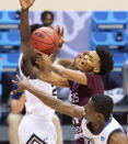Texas Southern forward John Walker III (24) is fouled as he takes a shot during the first half of a First Four game against Mount St. Mary's in the NCAA men's college basketball tournament, Thursday, March 18, 2021, in Bloomington, Ind. (AP Photo/Doug McSchooler)