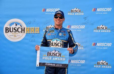 May 10, 2019; Kansas City, KS, USA; NASCAR Cup Series driver Kevin Harvick (4) poses for a picture after winning the pole for the Digital Ally 400 at Kansas Speedway. Mandatory Credit: Jasen Vinlove-USA TODAY Sports