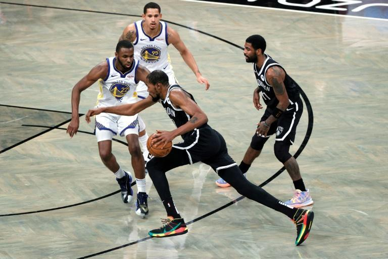Brooklyn's Kevin Durant drives past Golden State's Andrew Wiggins in the Nets' win over the Warriors in the opening game of the 2020-21 NBA season
