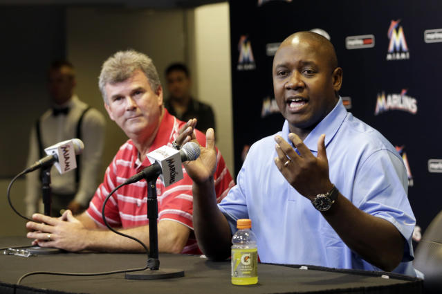 Miami Marlins' Michael Hill, right, talks to the media at a news conference after being promoted to president of baseball operations as new general manager Dan Jennings, left, looks on Sunday, Sept. 29, 2013, in Miami. (AP Photo/Alan Diaz)