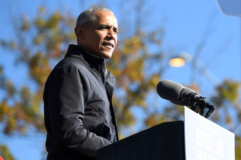 FILE PHOTO: Former President Barack Obama addresses voters one day before the election, in Atlanta, Georgia