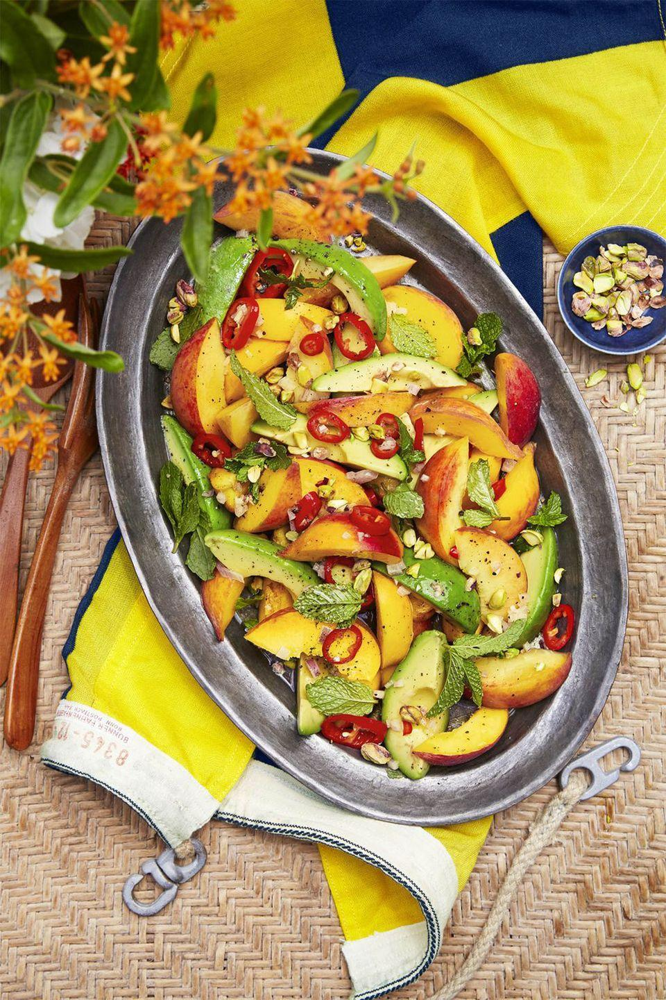 """<p>Fresno chiles add a kick to creamy avocados and sweet peaches in this colorful salad.</p><p><strong><a href=""""https://www.countryliving.com/food-drinks/recipes/a43551/spicy-peach-avocado-salad-recipe/"""" rel=""""nofollow noopener"""" target=""""_blank"""" data-ylk=""""slk:Get the recipe"""" class=""""link rapid-noclick-resp"""">Get the recipe</a>.</strong> </p>"""