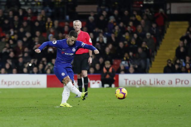 Chelsea's Eden Hazard, scores from a penalty his side second goal during the English Premier League soccer match between Watford and Chelsea at Vicarage Road stadium in Watford, England on Wednesday, Dec. 26, 2018. (AP Photo/Frank Augstein)