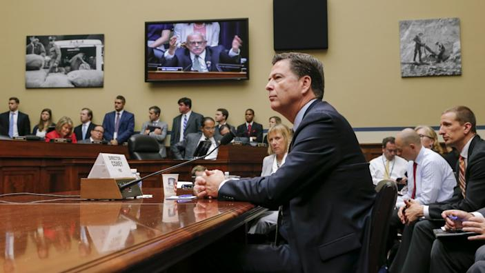 House Oversight Committee member Gerry Connolly, D-Va., can be seen on a TV screen, center, as he addresses FBI Director James Comey. (Photo: J. Scott Applewhite/AP)