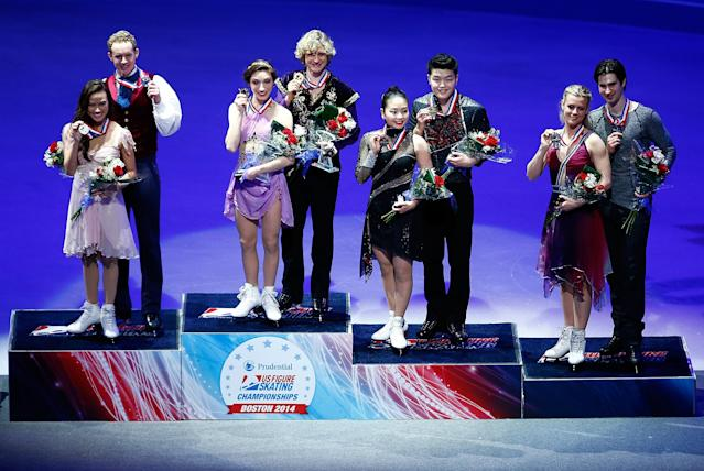 BOSTON, MA - JANUARY 11: Winners of the free dance program stand on the podium during the awards ceremony during the 2014 Prudential U.S. Figure Skating Championships at TD Garden on January 11, 2014 in Boston, Massachusetts. (Photo by Jared Wickerham/Getty Images)