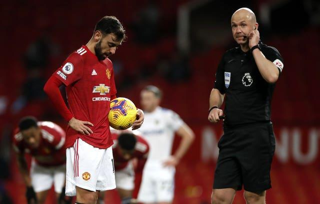 Referee Anthony Taylor in communication with his VAR colleague